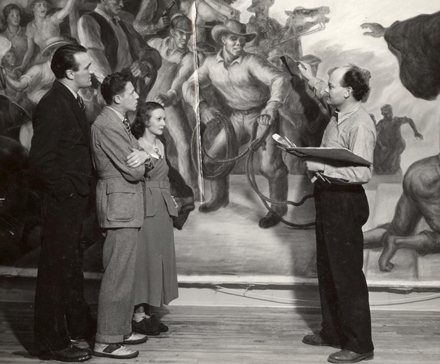 Univeristy of Wisconsin faculty and artist in residence John Steuart Curry (right) speaks with three onlookers about the mural he's at work on. UW Digital Collections/ID S10117