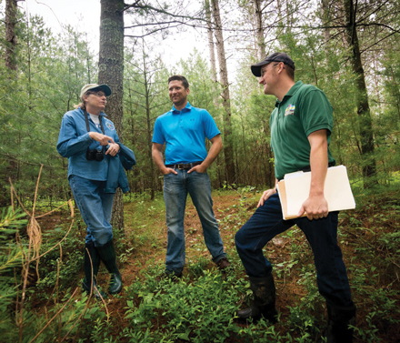 Nancy Bozek (left), a UW–Stevens Point faculty member and Director of the Wisconsin Woodland Owners Association, and Wisconsin DNR Region Team Supervisor Andrew Sorenson (right) talk with Kevin Ponsler (center), a Procurement Manager for Biewer Lumber, about to how to responsibly harvest a forested area in Wood County while maximizing its capacity for carbon capture. Photo credit: WDNR