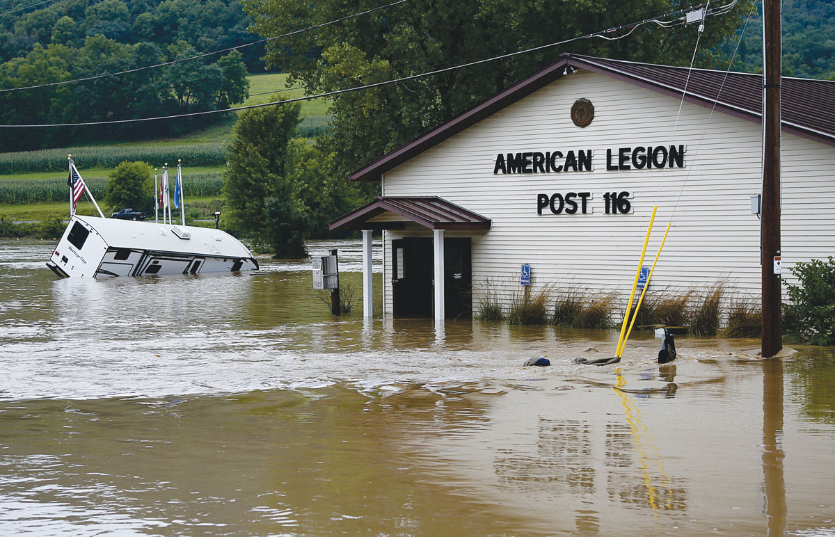 The Coon Valley American Legion Post 116 Building received four feet of water inside. The force of the water opened the locked doors at both ends of the building, and most of the chairs inside floated downstream. Most of the historical artifacts—CV Legion History Books, photos, uniforms, and awards—were preserved. Photo by Jon Lee.