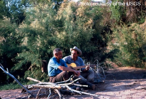 In the midst of a research expedition in Cataract Canyon, Utah, former USGS Chief Hydrologist Luna Leopold and eminent physicist Ralph Bagnold take a moment to rest.
