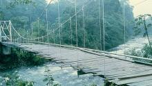 The road to the Tirimbinia Reserve runs across a rickety suspension bridge over the Sarapiquí River. Photo by Sherman Gessert/Milwaukee Journal