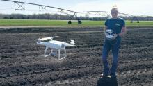 Moriah Rataczak uses her Phantom 4 quadcopter—more commonly known as a drone—to monitor field conditions for Gumz Farms. Photo by Cassie Smith-Krebs.