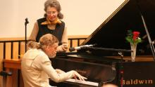 Leslie Lemke sits at the piano