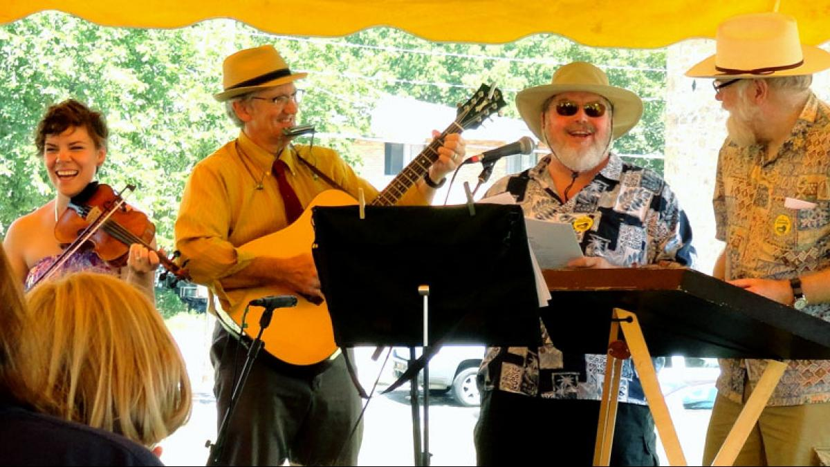 Above (l to r): Ruthie Krause, Rick Krause, a festival volunteer, and Ben Doran lead a group sing along at the 2013 Gandy Dancer Festival in Mazomanie.