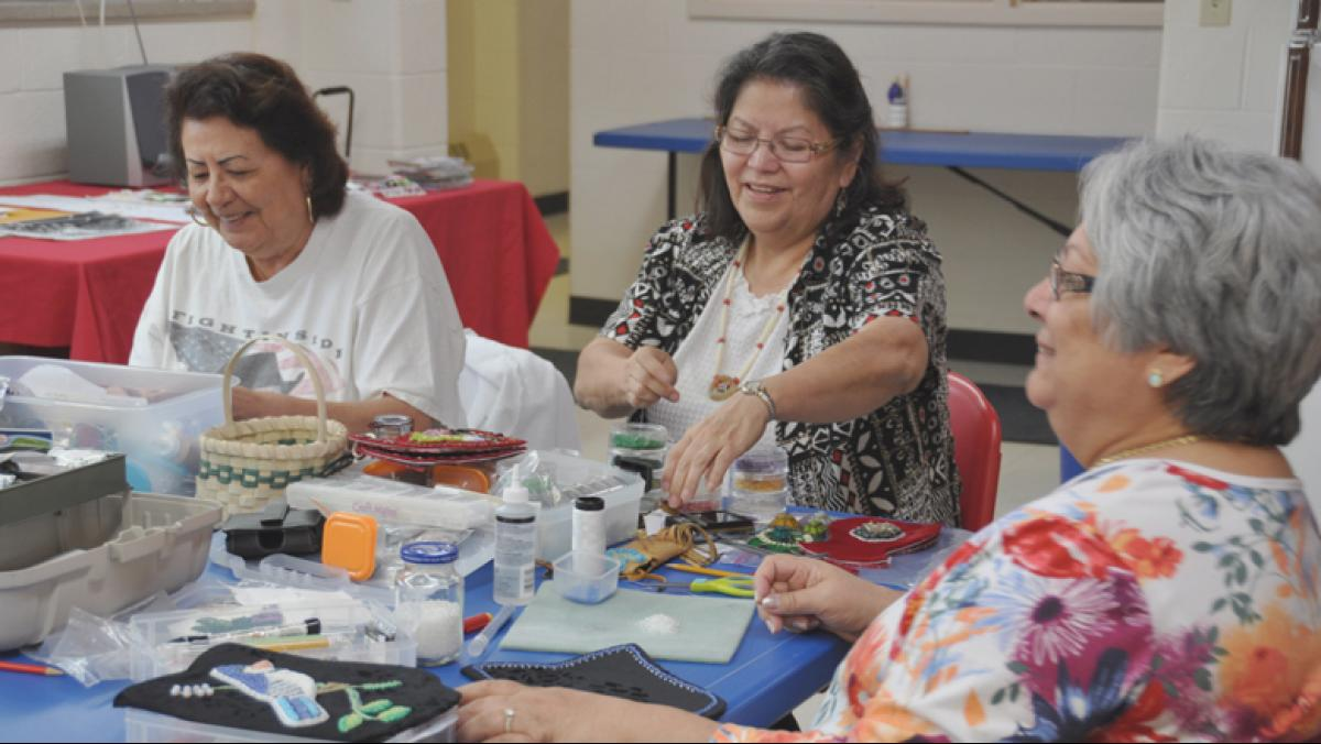 A beading workshop at the Oneida Nation Arts Program.  Pictured, left to right: Sandra Wescott Gauthier, Judith L. Jourdan, Betty Willems.