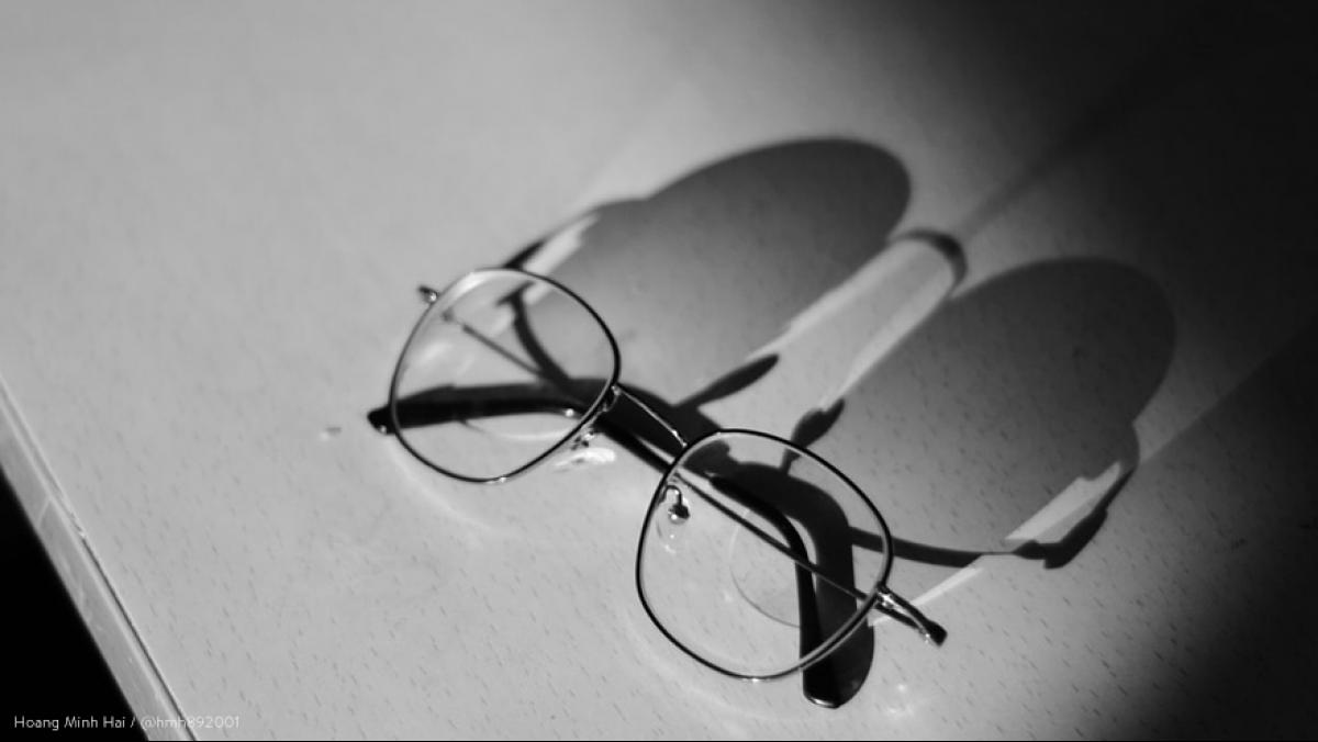 A black and white photo of glasses