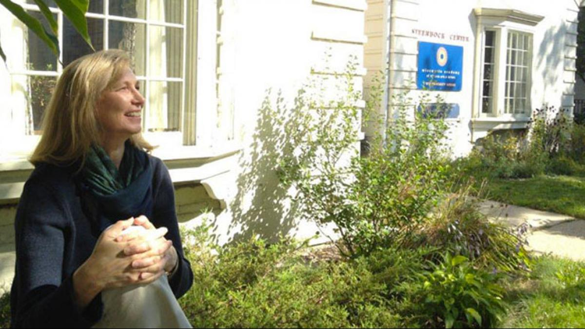Photo of Jane Elder in front of Academy offices