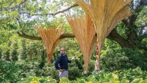 Peter Krsko stands amidst Renewal (with collaborating artist Katie Schofield's Turkey Tails), one in a series of bio-inspired art installations on view at Olbrich Botanical Gardens in Madison. Photo by TJ Lambert/Stages Photography.