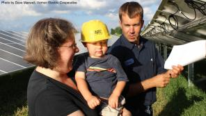Family purchasing a share in the Vernon Electric Cooperative solar farm. Photo by Dave Maxwell.