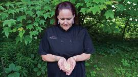 Chef Elena Terry holds ancestral corn seeds. Photo by Tom Jones. No reproduction without permission.