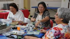 Beaders (l to r) Sandra Gauthier, Judith Jourdan, and Betty Willems at an Oneida Nation Arts Program workshop in 2013. Learn more about Oneida raised beadwork. Photo by Anne Pryor.