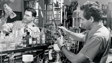 Karl Paul Link (right), the biochemist who discovered warfarin, and Mark A. Stahmann (left) perform a laboratory procedure at the Wisconsin Agricultural Experiment Station in 1949.  UW Digital Collections/ID S05108