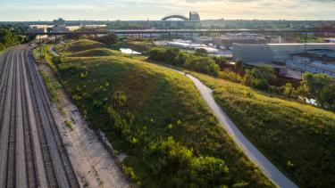 This 24-acre stretch of land along the Menomonee River in Milwaukee used to be an abandoned rail yard. In 2013 a group of state and local partners completed its transformation into an urban green space. Today, Three Bridges Park is home to an urban ecology center and bike paths, and hosts over 50,000 visitors every year. Photo by Jon Elliott/MKE Drones.